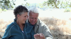Affectionate mature couple outdoors Stock Footage
