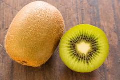 Kiwi fruit on brown wooden background - stock photo