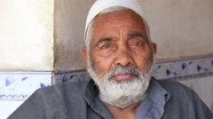 Portrait of an Indian muslim man in the market in Srinagar, Kashmir, India Stock Footage