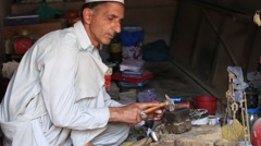 Indian jewelers at work in his workshop. Srinagar, Kashmir, India Stock Footage
