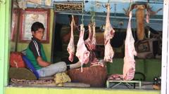 Indian butcher sells lamb market in Srinagar. India Stock Footage