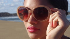 Young woman adjusting sunglasses Stock Footage