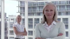 Two businesswomen in office, portrait Stock Footage