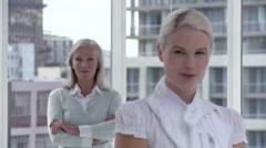 Two businesswomen in office, portrait - stock footage