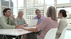 Five businesspeople in office meeting Stock Footage