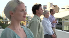 Four businesspeople in a row, looking away Stock Footage