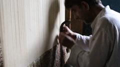 Indian man weaves a carpet Kashmir at weaving factory in Srinagar. India Stock Footage