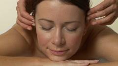 Woman having face massage Stock Footage