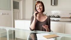 Woman on telephone with credit card Stock Footage