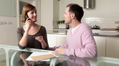 Couple on telephone with credit card Stock Footage
