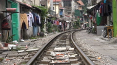 People dry clothes and live besides the railway tracks in Hanoi, Vietnam Stock Footage