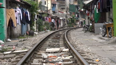 Drying clothes on the washing line, railway tracks, Hanoi 'slums', Vietnam Stock Footage