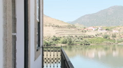 Stock Video Footage of Couple walking onto balcony overlooking douro river