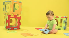Baby boy playing with toy alphabet letters Stock Footage