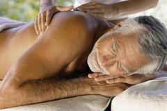 Man being massaged Stock Photos