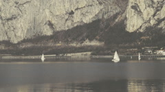 Sail boats on the lake and mountains in the background Stock Footage
