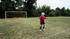 Girl practicing soccer skills Stock Footage