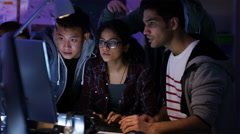 4K Team of young computer hackers trying to gain access to a computer system - stock footage