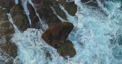 Vertical Shot of Large surf crashing against a rock Stock Footage