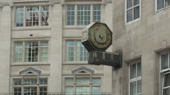 Old clock with golden details on a wall in London Stock Footage