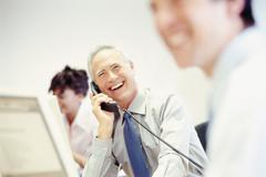 Businessman on telephone in office Stock Photos