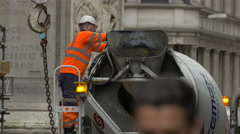 Man washing a concrete mixer truck in London - stock footage