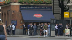 People gathered in front of East India Arms pub in London Stock Footage