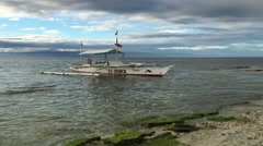 Catamaran Boat in the water during low tide Stock Footage