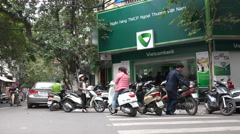 Motorbike parking lot in front of Vietcom bank office in Hanoi, Vietnam Stock Footage