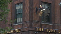 The Hung Drawn Quartered pub's name in London Stock Footage