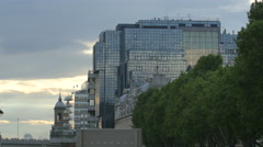 View of a glass building and a church tower in London Stock Footage