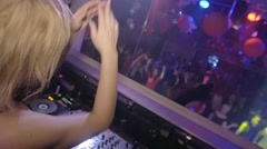 Back side of Dj girl dance, jump, clap at turntable. Club. Slow motion. People - stock footage