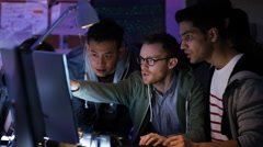 4K Team of young computer hackers trying to gain access to a computer system Stock Footage