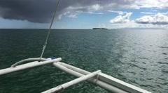 Catamaran Boat leaving Panglao bay Stock Footage