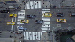 View from tall building downward angle in Midtown Manhattan busy intersection Stock Footage