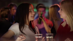 Girls gossip at the bar Stock Footage