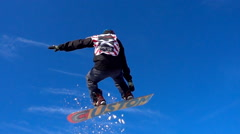 Snowboarder jumping high on the powder snow. - stock footage