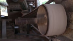 60fps POV of power belt looping around an industrial pulley - stock footage