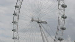 London Eye rotating on a cloudy day in London Stock Footage