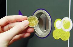 Machine accepting euro coins - stock photo
