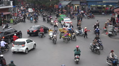 Flower vendor, busy traffic, motorbikes, bicycles, Hanoi intersection, Vietnam - stock footage