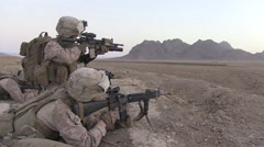 War in Afghanistan - U.S. Marines survey enemy occupied ridge on mission Stock Footage