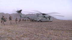War in Afghanistan - U.S. Marines exit helicopter on way to combat mission Stock Footage