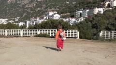 Trekking shot child walking away Stock Footage
