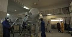 Men In Workshop Using Mixer To Mix Powder (4K) Stock Footage