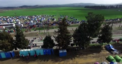 Thousands of immigrants are in a wait at the border between Greece and FYROM - stock footage