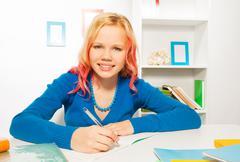 Happy girl smile, write in textbook doing homework Stock Photos
