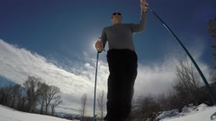 Family cross country skiing on a sunny day Stock Footage