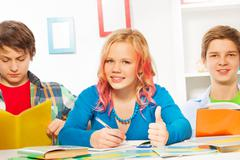 Thumb up homework - girl with friends at home Stock Photos