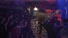 Back side two go go girls on stage of nightclub. Slow motion. Long hair. People - stock footage
